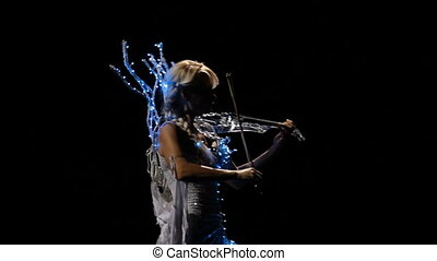 Magic violinist - Beautiful blonde girl playing the violin...