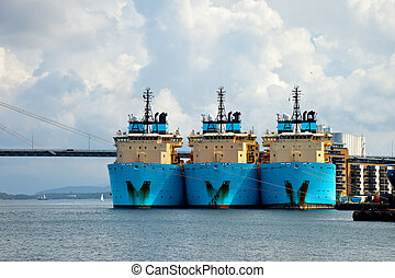 Large tugs in port - Three large tugs berth in the port of...