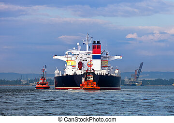 Towing the tanker - Maneuvers at sea on a cloudy day -...