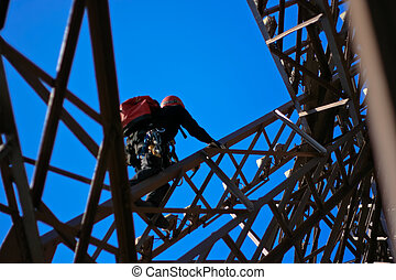 Maintenance on the eiffel tower - man climbing eiffel tower...