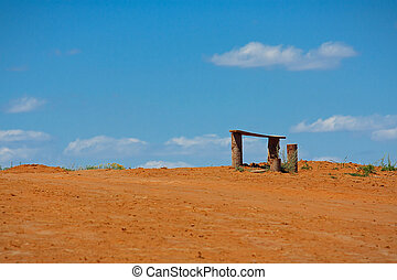The lonely bench in summer asian steppe