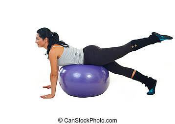 Woman training on pilates ball isolated on white background