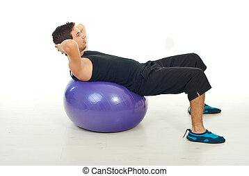 Man doing abs on pilates ball over white background