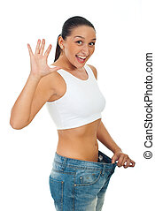 Extremely happy slim woman showing progress - Extremely...