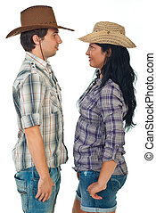 Couple face to face in cowboy hats - Couple wearing cowboy...