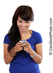 Pretty Asian Woman, text on her cellphone with happy face