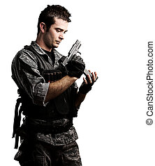 young soldier - portrait of young soldier reloaing his gun...