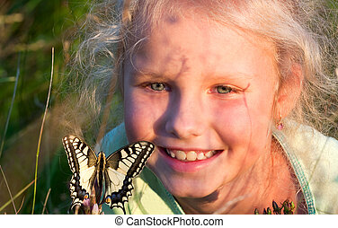girl portrait and butterfly - Small girl in wild grasses...