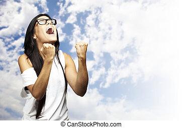 woman winner - portrait of young woman winner gesture...