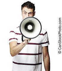 man with megaphone - portrait of young man shouting using...