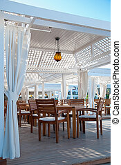 Outdoor cafe - Tables and comfortable chairs in outdoor cafe...