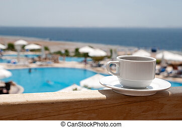 Cup of coffee - White cup of coffee near sea beach and pools