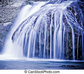 Winter waterfalls in mountains.