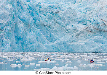 Kayaking at glacier - Kayaking near the foot of majestic...