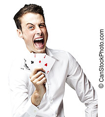 excited man - portrait of crazy man showing poker cards...