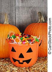 candy filled halloween pumpkin - closeup candy filled...