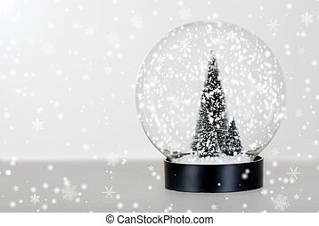 Christmas tree snow globe - closeup Christmas tree snow...