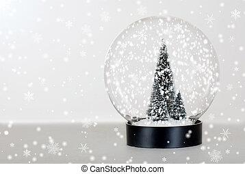 Christmas tree snow globe - closeup Christmas tree snow...