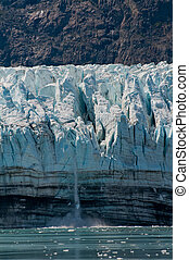 Small glacial calving - Closeup of small glacial ice calving...