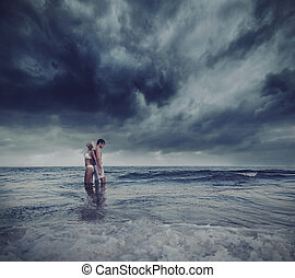 Hugging lovers in the sea