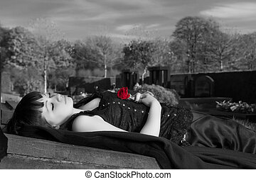 Black and white widow - Gothic widow lying on a tombstone...