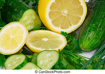 The fresh lemon, cucumbers and greens for diet ration