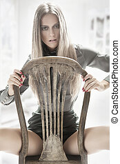 Cute woman sitting on a old chair