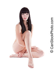 Studio shot of naked beautiful brunette woman