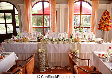 Wedding reception table set awaiting guests and food