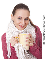 Young woman with cup in winter sweater and scarf - Young...