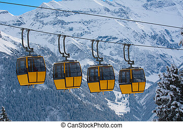 Cablecar in alps - Cablecars on the skiing resort Braunwald...
