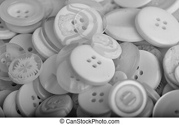 black and white buttons - a pile of different which buttons...