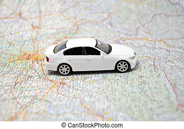 concept small white toy car on italy map
