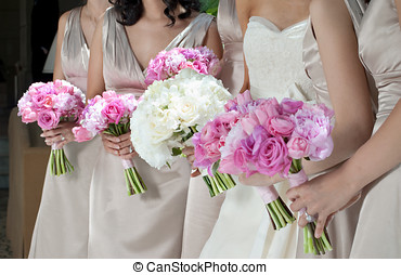 Bride and Bridesmaids with Bouquets - Wedding Bouquets in...