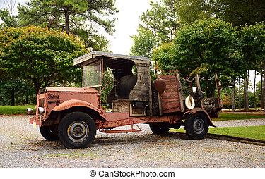 Jalopy - Old rusty truck in a barely functional state.