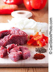 raw ingredients of a hungarian goulash dish