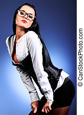 business woman - An attractive young woman in spectacles...