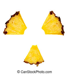 Radioactivity symbol made from pineapple pieces over white...