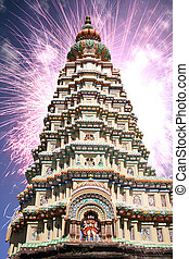 Diwali Temple - Fireworks exploding behind a hindu temple on...