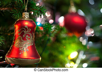 Christmas Ornament with Lighted Tree in Background, Copy...