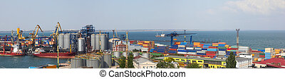 Panorama view on the port with loading cargo ship