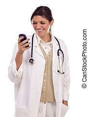 Ethnic Female Doctor or Nurse Using Cell Phone - Pretty...