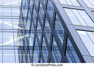 Glass facade - Blue glass facade of office building with...
