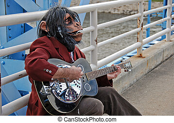 Monkey Man guitarist - Man with monkey mask playing a guitar...