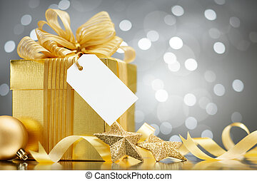 christmas gift with blank tag against bokeh lights...