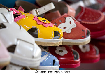 colorful childrens shoes are in line with the shallow depth...