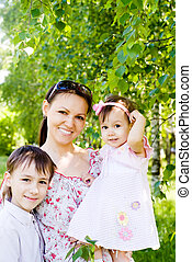 mom and kids at nature - portrait of a mom with her kids
