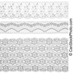 Lace trims ribbon over white. Set of embroidered fabric. Closeup
