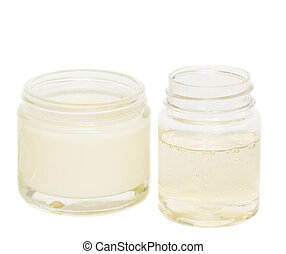 jars with cream and lotion isolated on white background