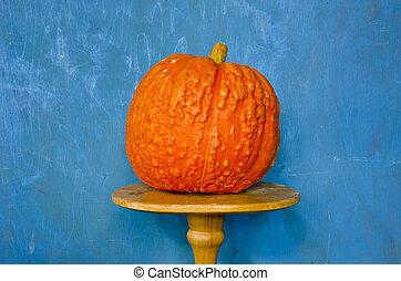 still-life with orange pumpkin